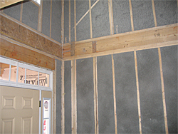 Caulked framing and tightly insulated walls